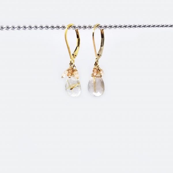 "Golden rutilated quartz drops are finished with gold-filled, lever back closure. The earrings measure 1.25"" long."