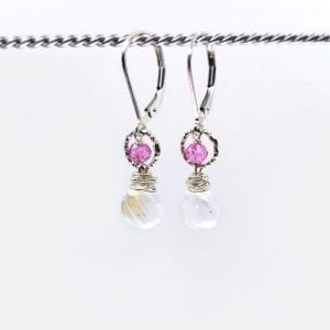"Rainbow moonstone and pink topaz briolettes are suspended from gold-filled, lever back closure earrings. The earrings measure 1.25"" long."