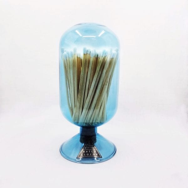 "Glass cloche design match holder with corked bottom holds 120 4"" matches. Strike plate on back. Color: Sky"